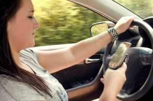 15865-a-teen-girl-texting-while-driving-pv